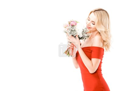 Photo for Attractive woman in red dress smelling flowers isolated on white - Royalty Free Image