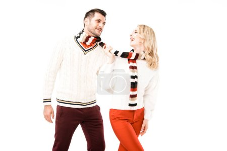 Photo for Happy adult couple in knitted scarfs having fun isolated on white - Royalty Free Image