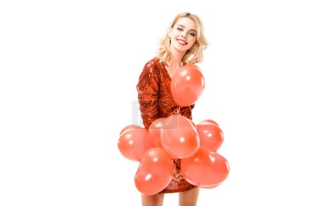 Attractive young woman in red dress with balloons isolated on white