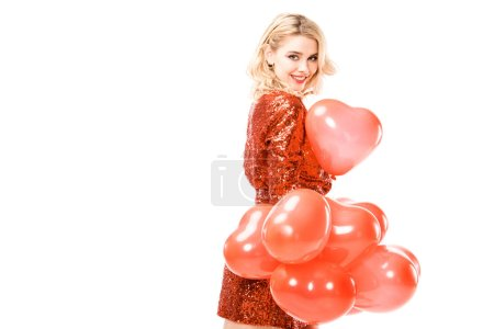 Beautiful adult woman in red dress with balloons isolated on white