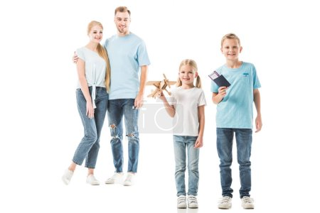 Happy parents smiling and looking at kids isolated on white
