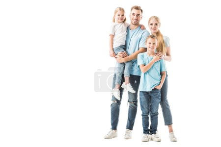 Happy family standing and smiling isolated on white