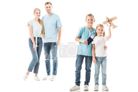 Happy parents looking at kids and smiling isolated on white