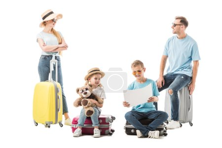 Photo for Family sitting on luggage and looking at map isolated on white - Royalty Free Image