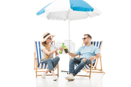 Couple sitting in sunglasses and drinking beer isolated on white