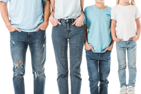 Cropped view of family standing in jeans with hands in pockets isolated on white