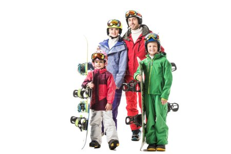 Happy family standing in colourful snowsuits and smiling isolated on white
