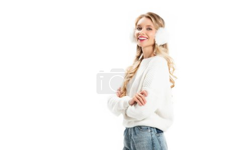 beautiful smiling woman in winter earmuffs posing with crossed arms isolated on white