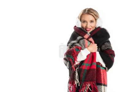 attractive smiling girl in cozy blanket isolated on white