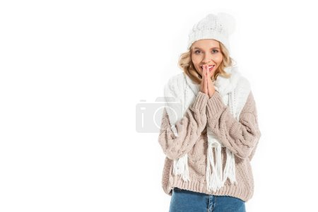 smiling beautiful girl in winter hat and sweater isolated on white