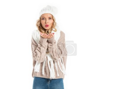 beautiful woman in winter outfit blowing kiss isolated on white