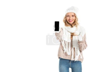 Photo pour Belle fille et montrant le pouce vers le haut et smartphone avec écran blanc isolé sur blanc - image libre de droit