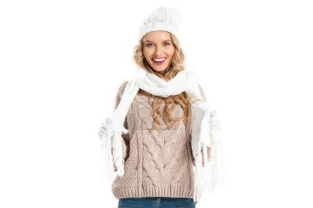Smiling girl in warm clothes looking at camera isolated on white