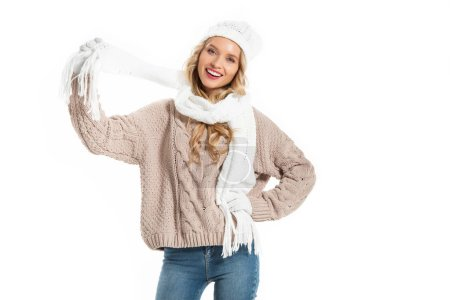 Attractive young woman in warm knitted clothes smiling isolated on white
