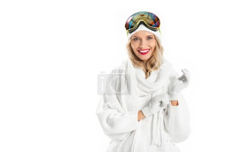 Photo for Nice young woman in warm clothes and ski goggles wearing  mittens isolated on white - Royalty Free Image