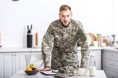 army soldier at kitchen table having breakfast