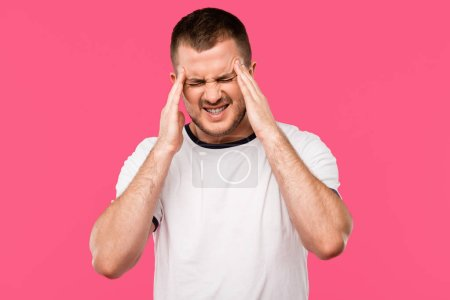 Photo for Young man having strong headache isolated on pink - Royalty Free Image