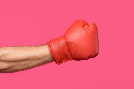 Photo for Cropped shot of male hand in boxing glove isolated on pink - Royalty Free Image