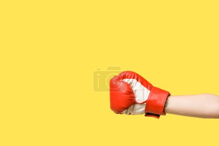 cropped shot of girl wearing boxing glove isolated on yellow