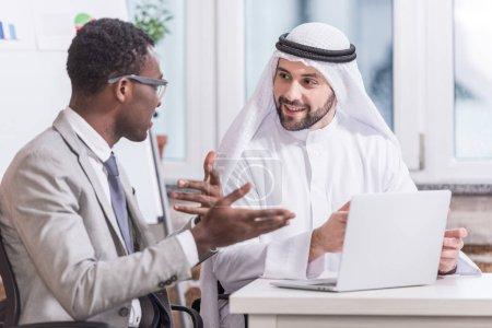 Multiethnic businessmen having discussion in modern office