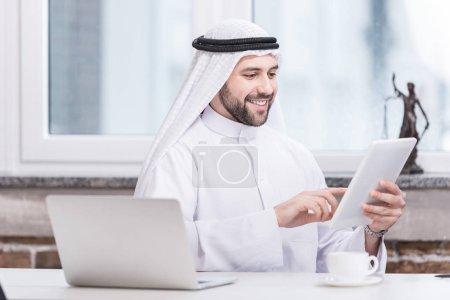 Arabian businessman using digital tablet in office