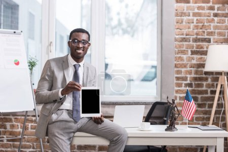 African american businessman showing digital tablet with blank screen