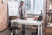African american businessman standing at office desk