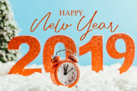 """big red 2019 numbers with vintage alarm clock standing on snow on blue background with """"happy new year"""" lettering"""