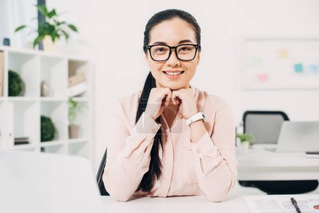 Attractive businesswoman  smiling in glasses in modern office