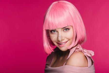 Photo for Beautiful stylish young woman in pink wig biting lip, isolated on pink - Royalty Free Image