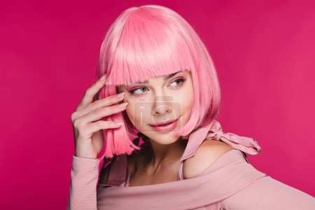 Photo for Beautiful stylish young woman posing in pink wig, isolated on pink - Royalty Free Image