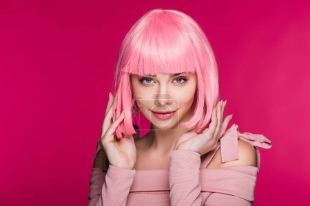 Photo for Beautiful stylish model posing in pink wig, isolated on pink - Royalty Free Image