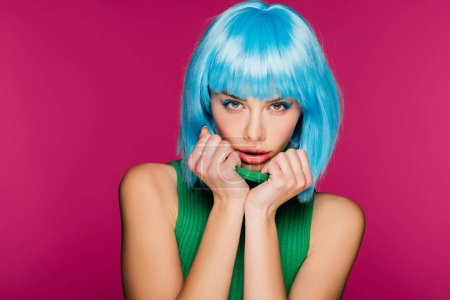 Photo for Fashionable charming girl posing in blue wig and green turtleneck, isolated on pink - Royalty Free Image
