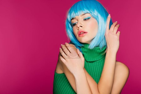 Photo for Attractive girl with blue hair gesturing and posing, isolated on pink - Royalty Free Image