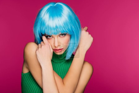 Photo for Beautiful model with blue hair, isolated on pink - Royalty Free Image