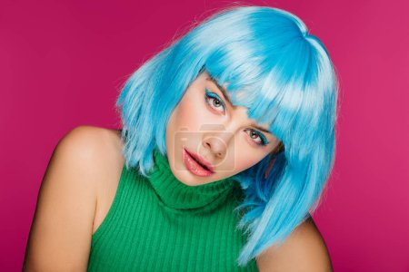 beautiful stylish girl posing in blue wig, isolated on pink
