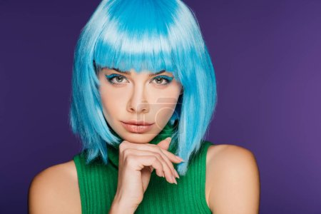 Photo for Pensive stylish girl posing in blue wig, isolated on purple - Royalty Free Image