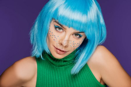 beautiful young woman with blue wig and stars on face, isolated on purple