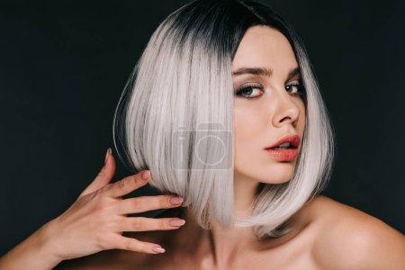 glamor fashionable girl posing in grey wig, isolated on black
