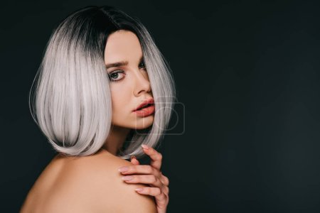 sensual naked model posing in grey wig, isolated on black