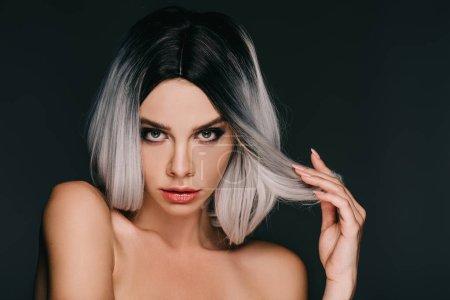 sensual glamor naked girl posing in grey wig, isolated on black