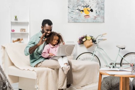 african american family using laptop in living room