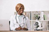beautiful african american scientist sitting with stethoscope