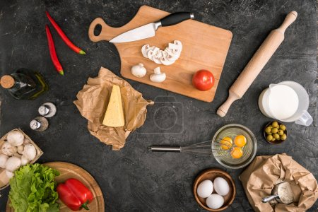 Photo for Top view of pizza ingredients and cooking utensils on grey background - Royalty Free Image