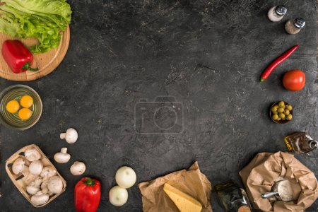 Photo for Top view of pizza ingredients with copy space on grey background - Royalty Free Image