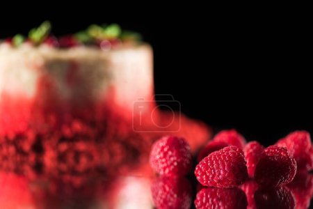 Photo for Selective focus of white cake decorated with red currants and mint leaves near raspberries isolated on black - Royalty Free Image