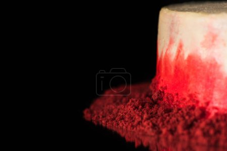 Photo for Selective focus of white and red cake isolated on black - Royalty Free Image