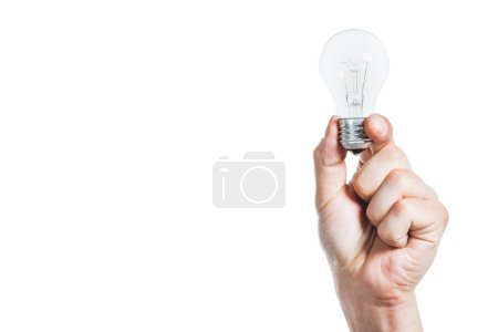 cropped view of male hand holding led lamp isolated on white, energy efficiency concept