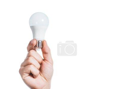 Photo pour Vue recadrée de l'homme tenant la lampe fluorescente isolé sur blanc, le concept d'efficacité énergétique - image libre de droit