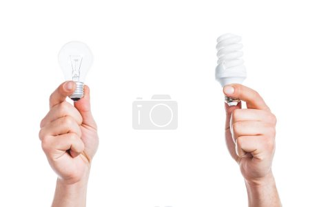 Photo for Cropped view of  male hands holding led and fluorescent lamps isolated on white, energy efficiency concept - Royalty Free Image